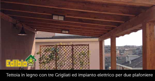 tettoia in legno con impianto di illuminazione